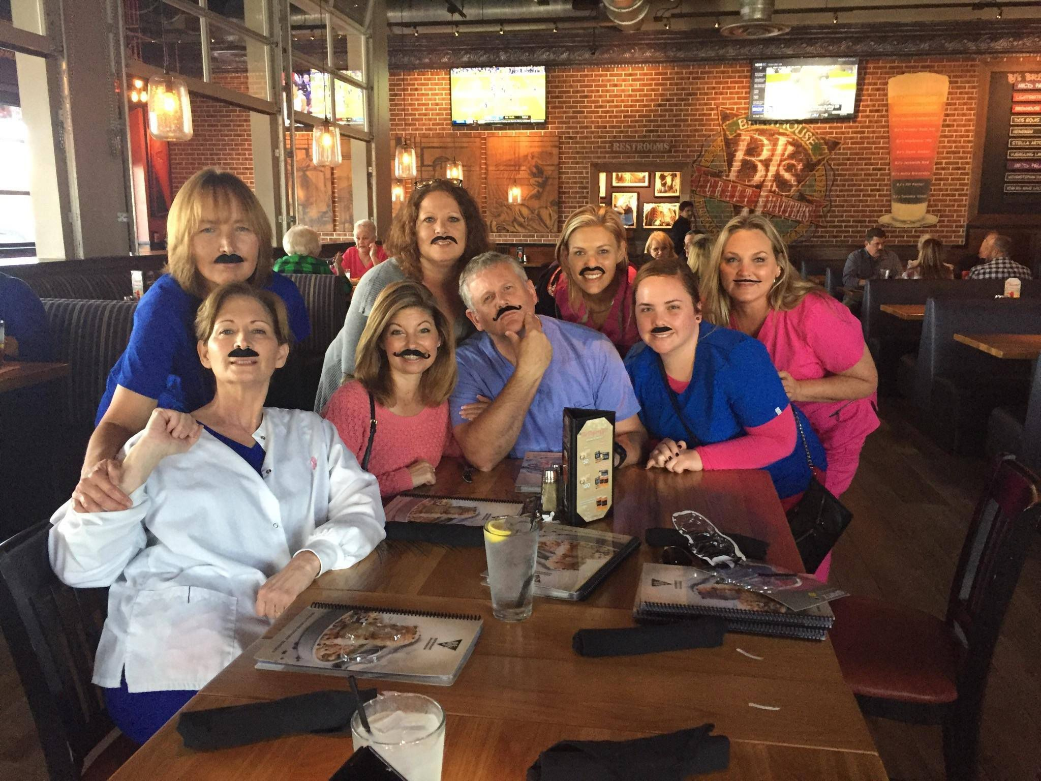 Dr. Lance Washburn and staff with silly mustaches