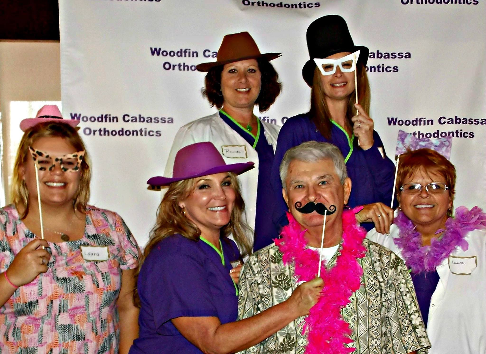 Dr. Lance Washburn and staff with photobooth props